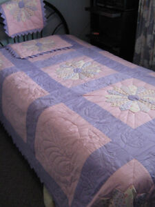Pink and mauve quilt featuring Dresden plate