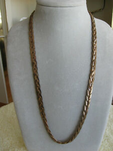 ....A BEAUTIFUL LONG BRAIDED SILVERTONE 28-INCH NECKLACE.['60's]
