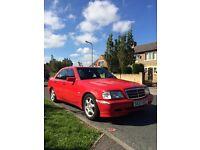 Mercedes Benz in red