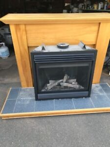 Propane fireplace and birch mantle