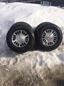 """95% 15"""" tire and rims. Gmc, Chevy"""