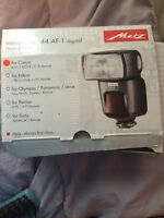 Selling 44 AF-1 digital Metz electronic flash for canon