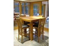 Bespoke solid oak (very heavy) high dining / bar table with 4 chairs (oak and leather)