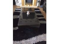 very heavy black glass coffee table