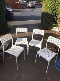 2 metal chairs with plastic seat and back rest
