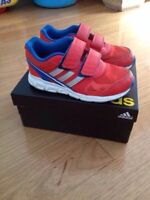 Adidas running shoes for a boy