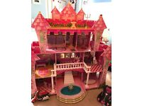 Large dolls house with furniture dolls and vehicles