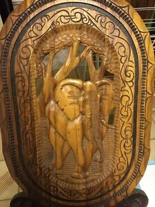 Two Hand Carved African Chairs