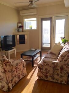 Condo on Whyte Ave, roommate, own bath, UG parking