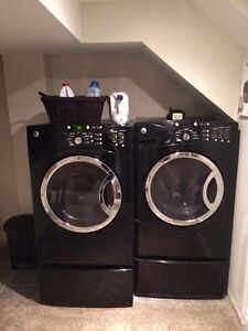 GE black electric front load dryer/washer w pedestals  London Ontario image 1