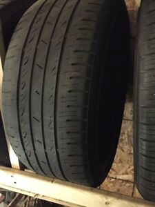 4 used and 1 brand new tire for sale