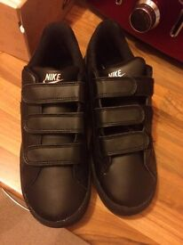 Black leather Nike trainers size 5