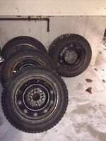 185 60 R15 snows tires on wheels