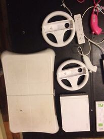 Wii, balance board, 2 controllers, 9 games