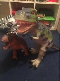 Two large toy dinosaurs