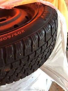 4 used tires and rims 205/60/16 St. John's Newfoundland image 1