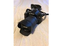 Nikon D90 camera 18-105 VR Kit comes with spare battery! May consider swaps
