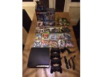 Play station 3 slim PS3 + 4 Controllers + 28 Games + Gaming camera