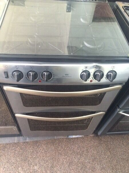 Stainless steel new world 60cm dual fuel cooker grill & fan oven good condition with guarantee