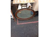 Antique oval mirror.