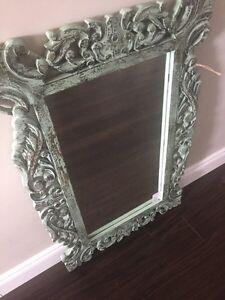 Floral carved wood framed mirror