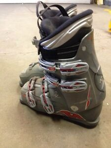 Boots, bindings, skis, poles, bag