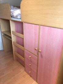 girls high sleeper bed in good cond with a quality clean mattress