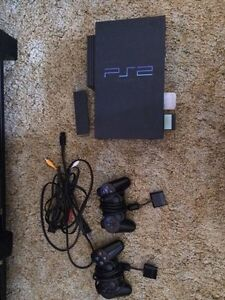 Ps2, 2 controllers, network adaptor, LOTS of games.