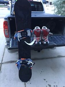 Limited snowboard and Salomon boots