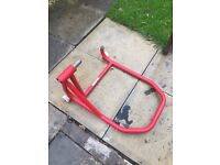 Paddock stand single side swing arm