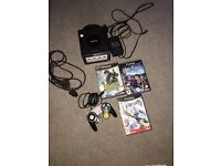 Nintendo GameCube with official remote + games. Game cube