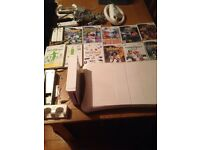 Nintendo wii with wii fit games and accessories