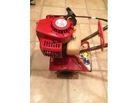 Mantis Petrol tiller, good running order, makes short work of digging beds and getting rid of weeds.