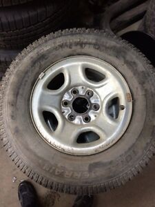 Six bolt chevy rims w/motomaster 245/75/16 winter tires 85%