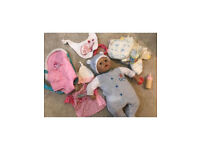 Baby doll bundle includes bottle, dummy and carrier