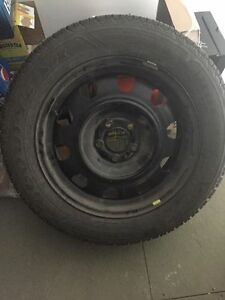 4 Studded Winter tires on rims. 225-55-R17