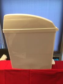 Brand new brilliant white sanitary bins