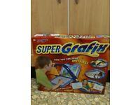 Super Grafix As New £10**