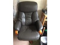 2 leather reclining armchairs with matching footstool