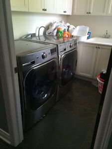 LG POWER STEAM WASHER AND DRYER.
