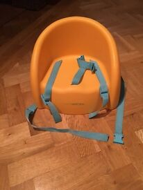 Mother are orange booster seat