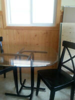 glass top table and 4 black ikea chairs