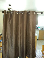 Brown Opaque window blinds with poles and hard ware