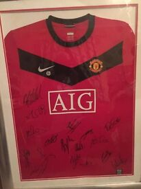 Man united signed top in frame