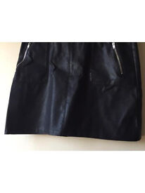 Immaculate never worn faux leather black skirt from new look size 10.