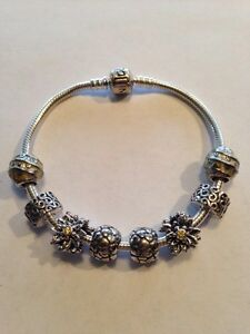 Pandora bracelet with 6 charms and 2 clips