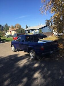 2003 Ford Ranger 4x4 C/W studded winters on rims Prince George British Columbia image 3