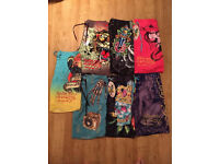 7 pairs of brand new Ed Hardy and Christian Audigier men's swim shorts. Some still with tags