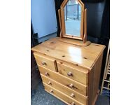 Pine chest of drawers and mirror.