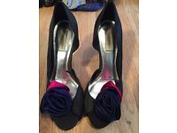 Ladies black heels with purple and pink rose